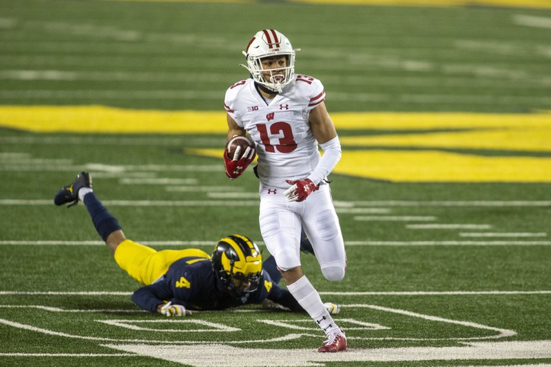 No. 13 Wisconsin routs Michigan 49-11 in 1st game in 3 weeks