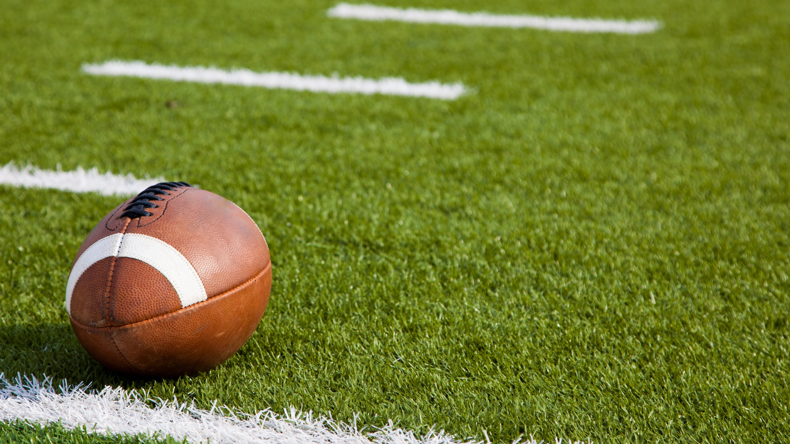 Spring high school football season underway in Wisconsin