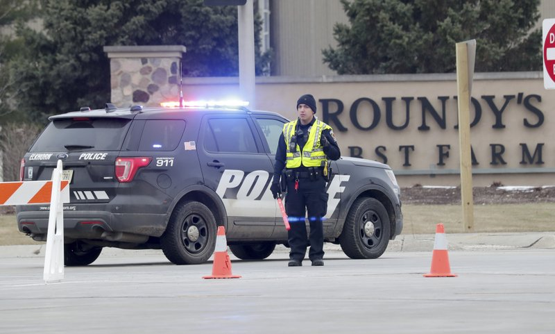 Police search for motive in fatal Wisconsin warehouse attack
